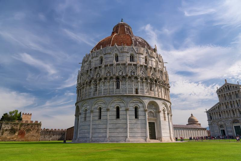 Magnificent daily view at the Pisa Baptistery of St. John, the largest baptistery in Italy, in the Square of Miracles Piazza dei. Miracoli, Pisa, Italy royalty free stock photo