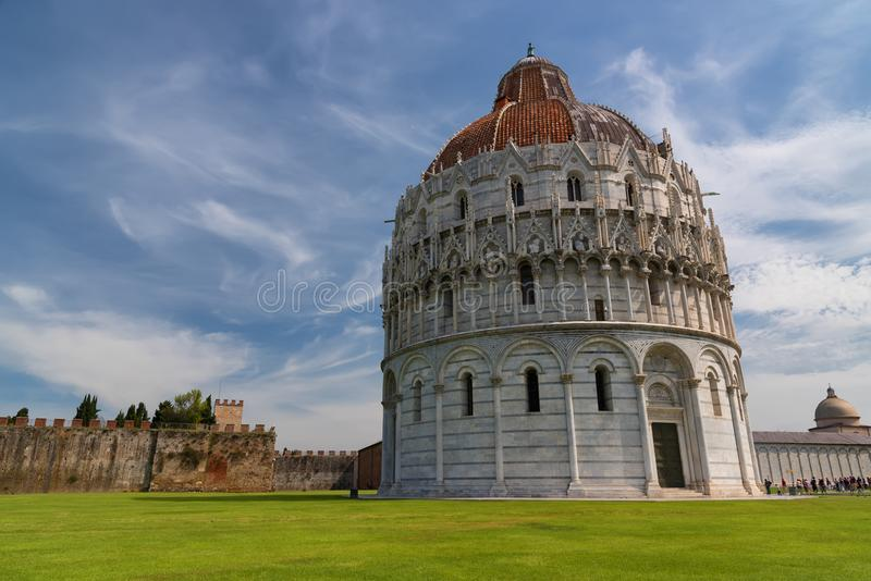 Magnificent daily view at the Pisa Baptistery of St. John, the largest baptistery in Italy, in the Square of Miracles Piazza dei. Miracoli, Pisa, Italy royalty free stock photos