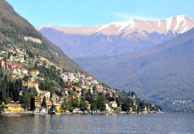 The magnificent view of the snowy mountain and houses near Lake Como, Italy royalty free stock image