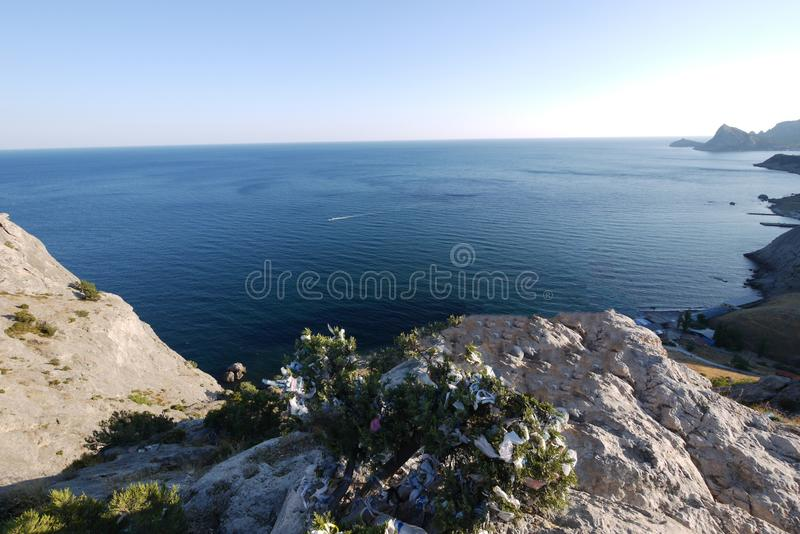 A magnificent view from the stony slope to the horizon line where the sea meets the sky. For your design stock photo