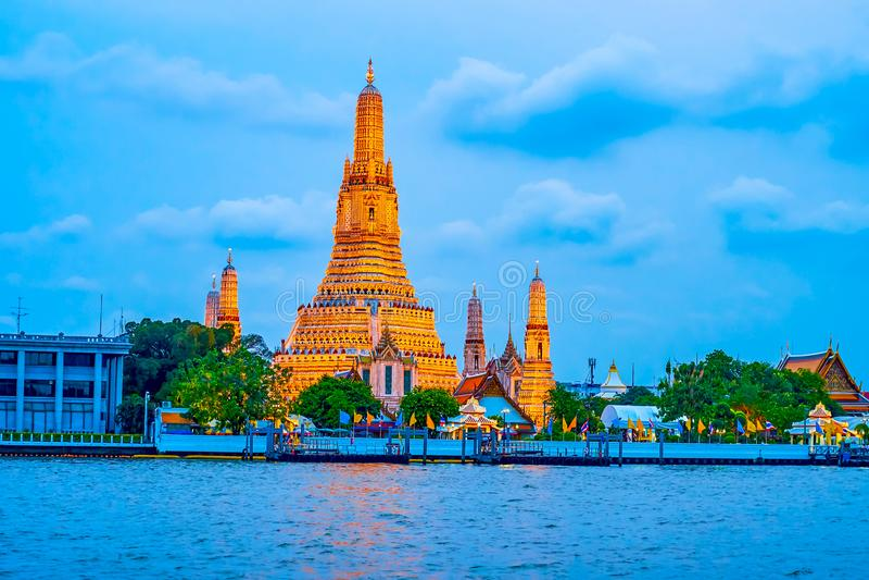 The Wat Arun temple in evening lights, Bangkok, Thailand royalty free stock photo