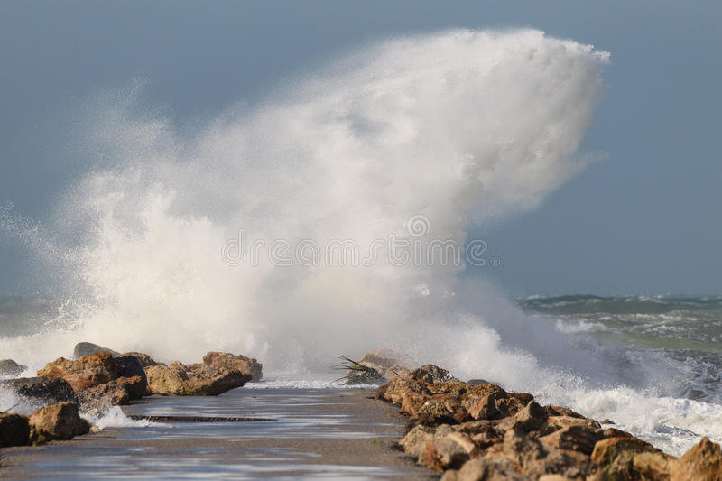 Magnificent wave crashes on North Jetty in Venice, Florida stock image