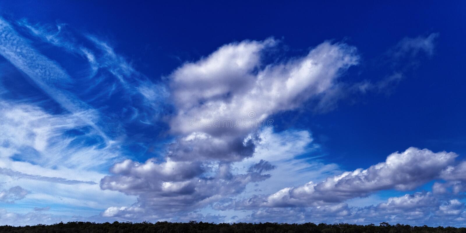 Magnificent white cumulonimbus cloud in blue sky. Australia royalty free stock photo