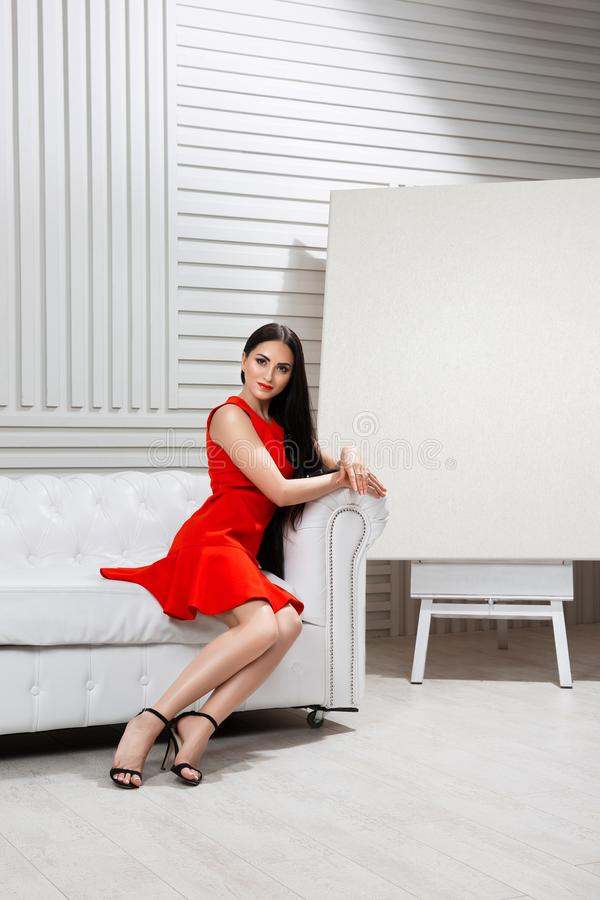 The girl in the white room royalty free stock image