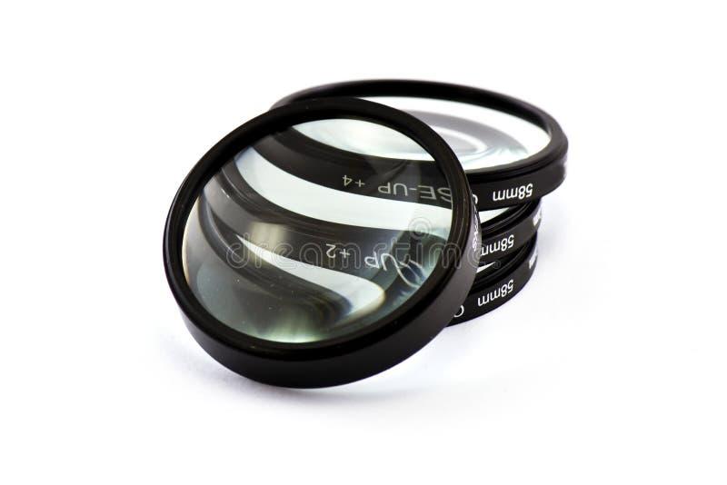 Magnified lenses in white. 4 Magnified lenses in white royalty free stock image