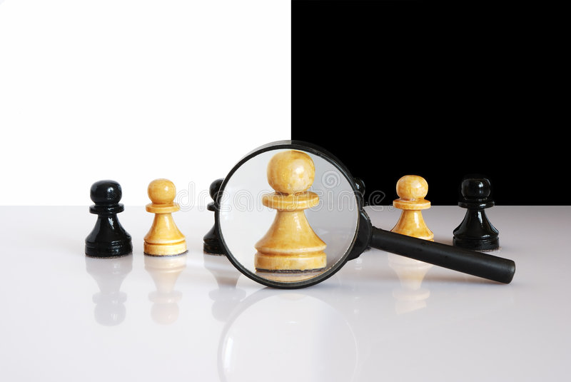 Magnified pawn stock photo