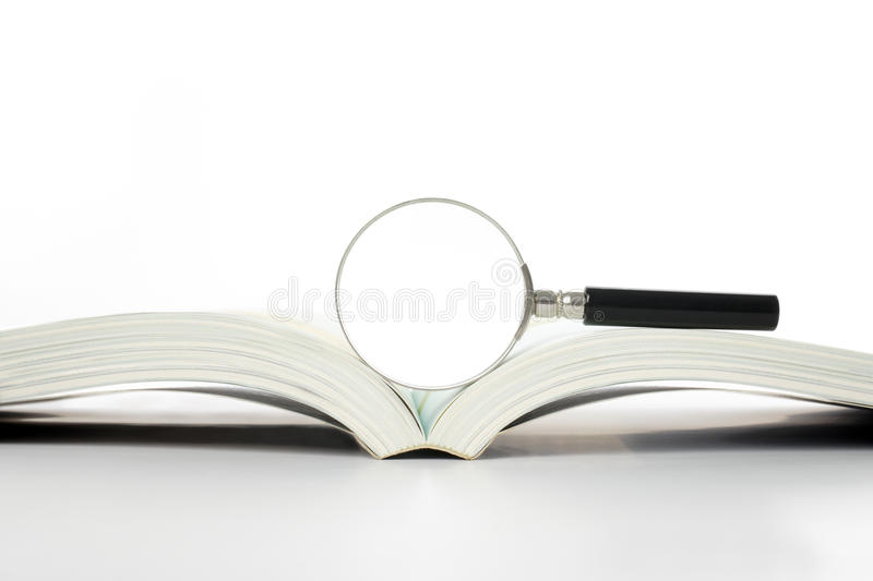 Magnifier And Book Stock Image