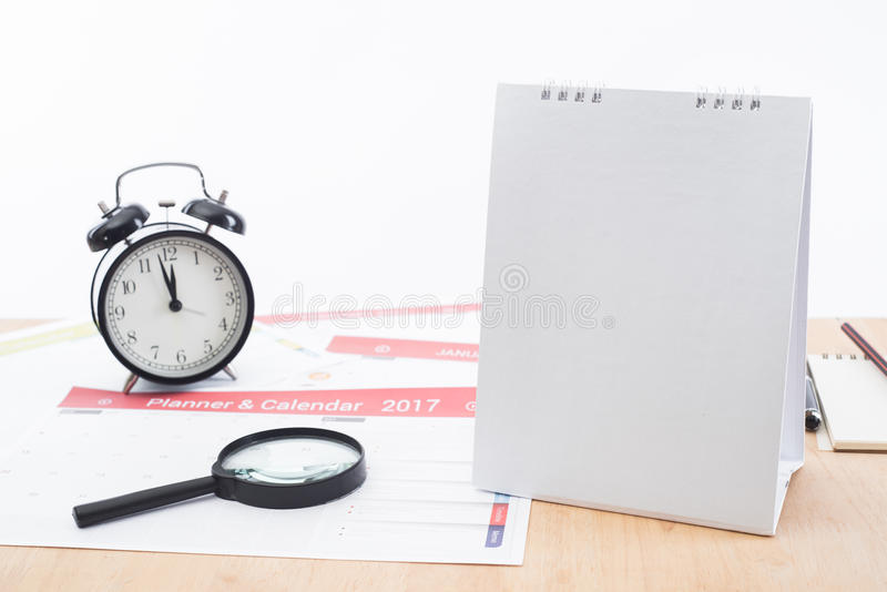 Magnifier and clock with business Calender Planner 2017 on desk office. stock images