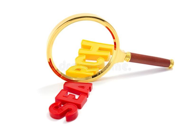 Magnifier con la ricerca di parola fotografie stock libere da diritti