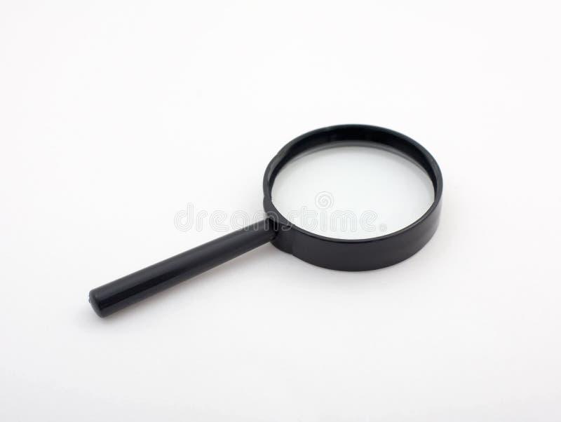 Magnifier da mão fotografia de stock royalty free