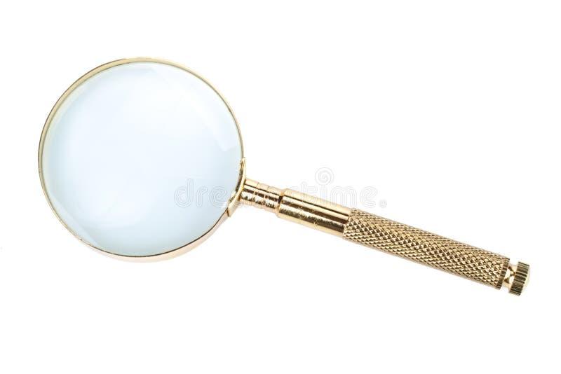 Magnifier do ouro imagem de stock