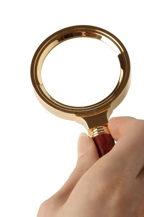 Magnifier em uma mão fêmea. Variação três. imagem de stock