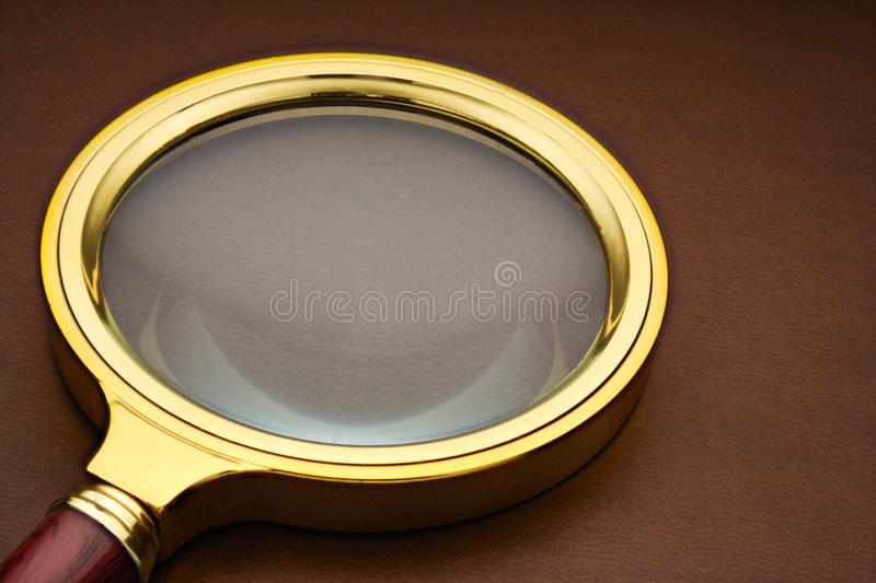 Magnifier on the leather surface. stock image