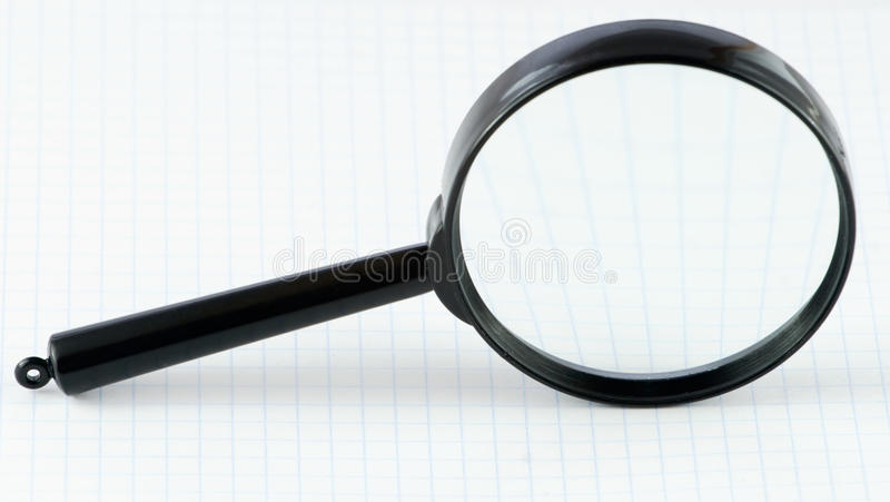 Magnifier on a math paper stock images