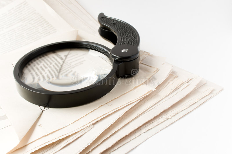 Magnifier and newspaper royalty free stock photos