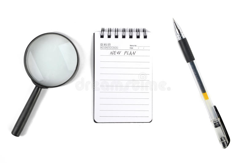 Download Magnifier And Notepad With Pen Royalty Free Stock Photos - Image: 23452598