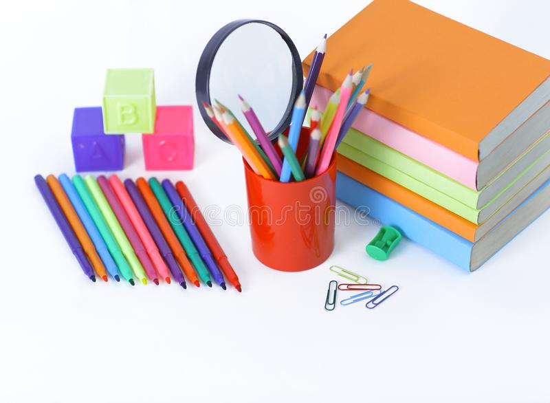 Magnifier, paper clip and school supplies on white background .photo with copy space royalty free stock photos