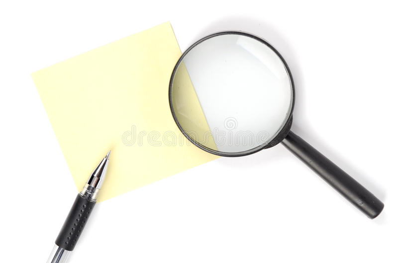 Magnifier,pen and notepaper royalty free stock photography