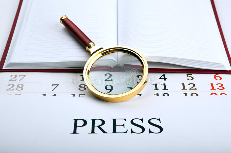 Magnifier and sign the press. Close up stock image