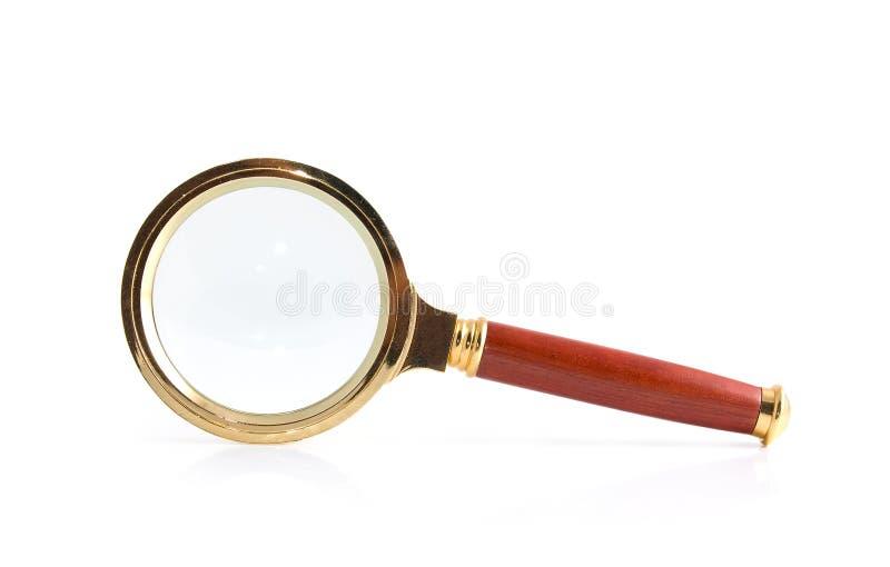 Magnifier su un bianco immagine stock