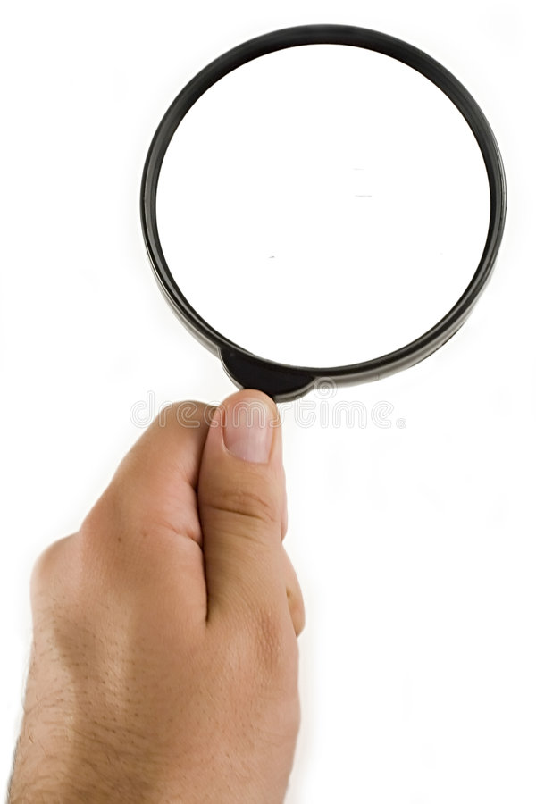 Magnify. Ing glass in hand, isolated on white royalty free stock images