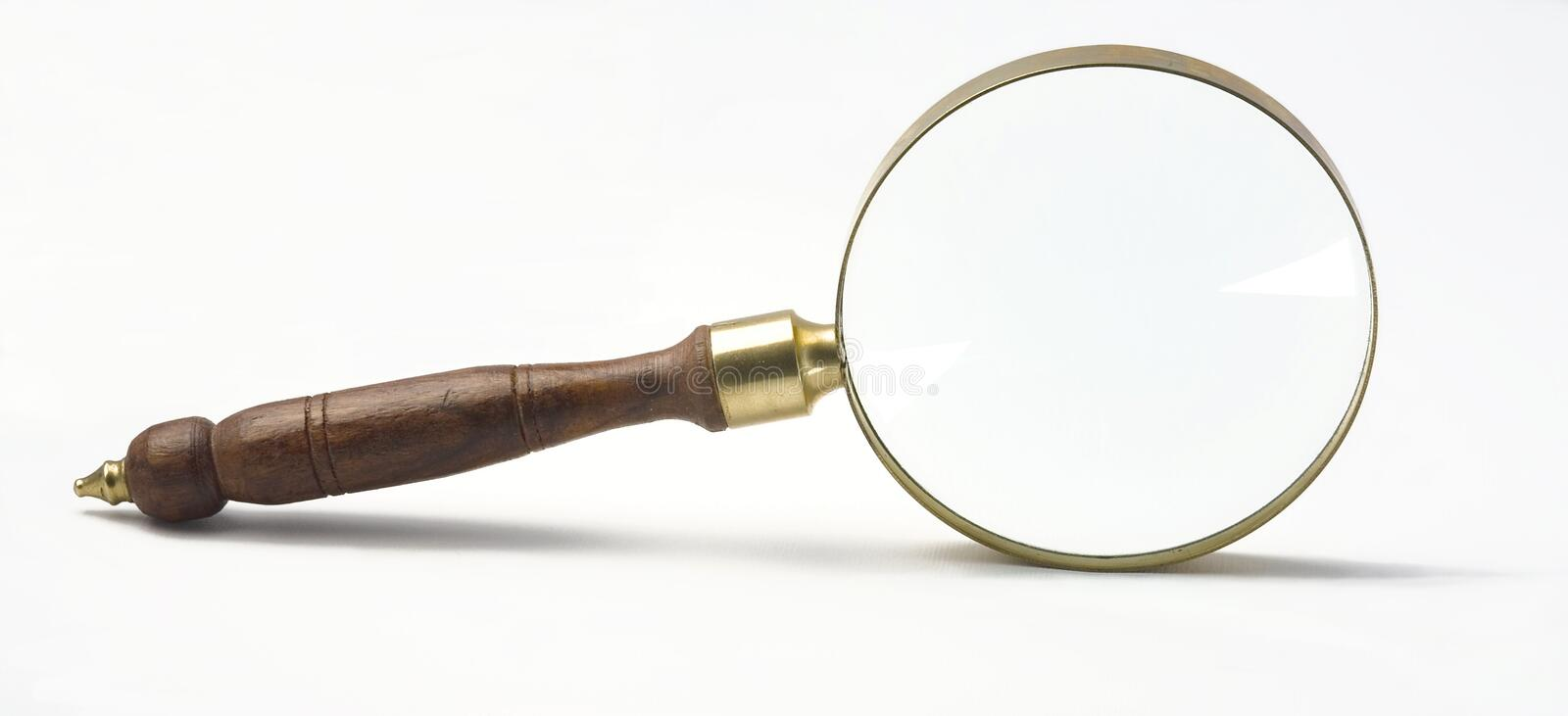Magnify glass. On white -wooden handel -coper royalty free stock image