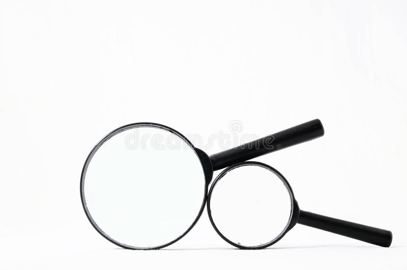 Magnify Glass Loupe. Isolated on a White Background royalty free stock photos