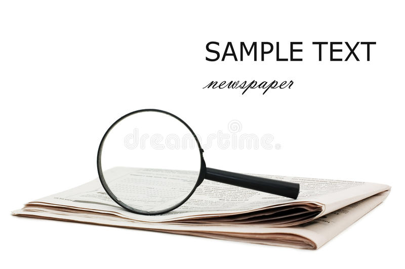 Magnify glass over a of newspaper. Still life royalty free stock image