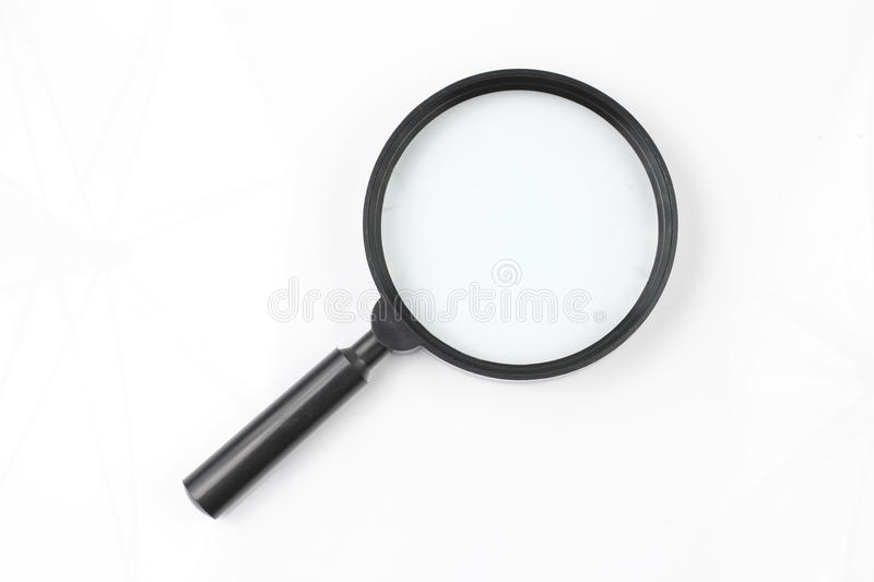 Magnify Glass on White background. Black Magnify Glass on White background Studio shot from Top view royalty free stock photography