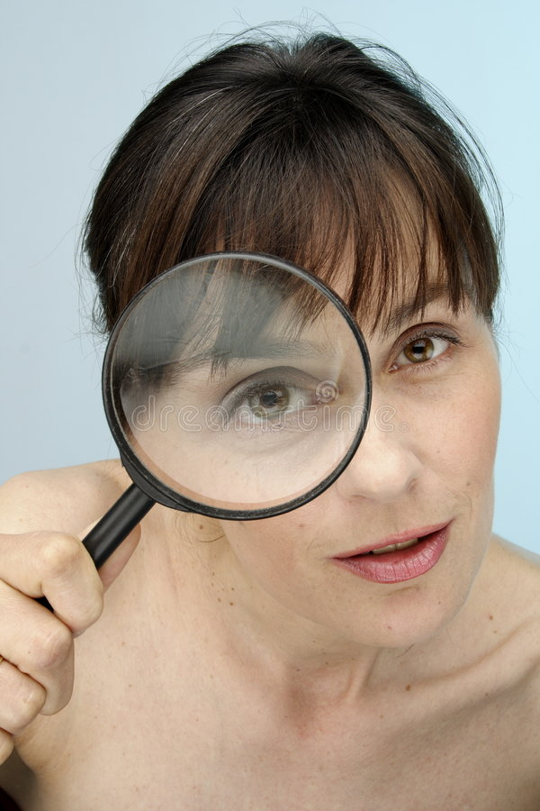 Magnifying glass. Model with magnifying glass - eye royalty free stock images