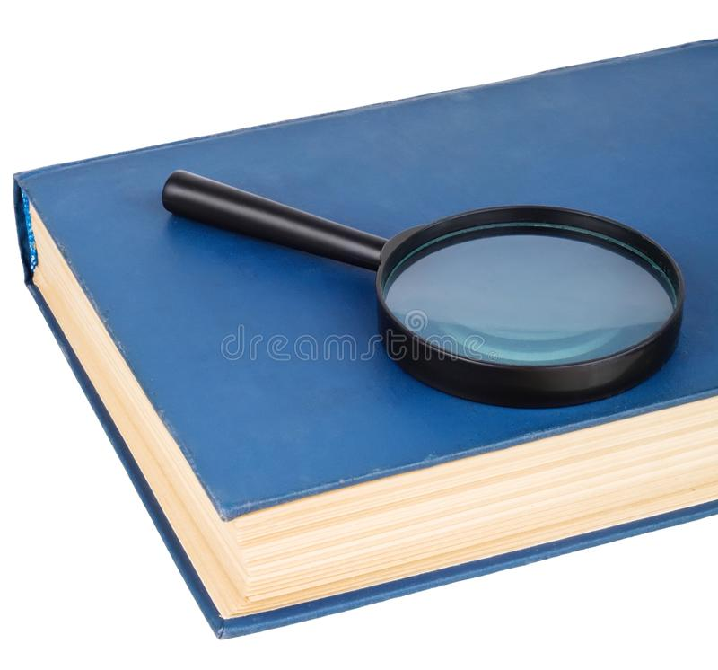 Download Magnifying Glass On A Blue Book Royalty Free Stock Image - Image: 13507276