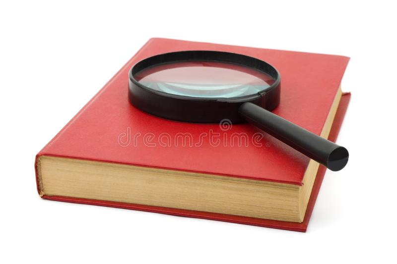 Magnifying glass on book royalty free stock image