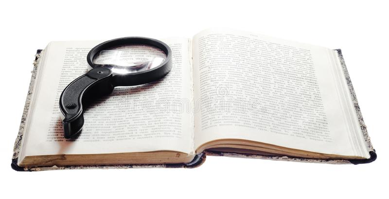 Magnifying Glass On Book stock images