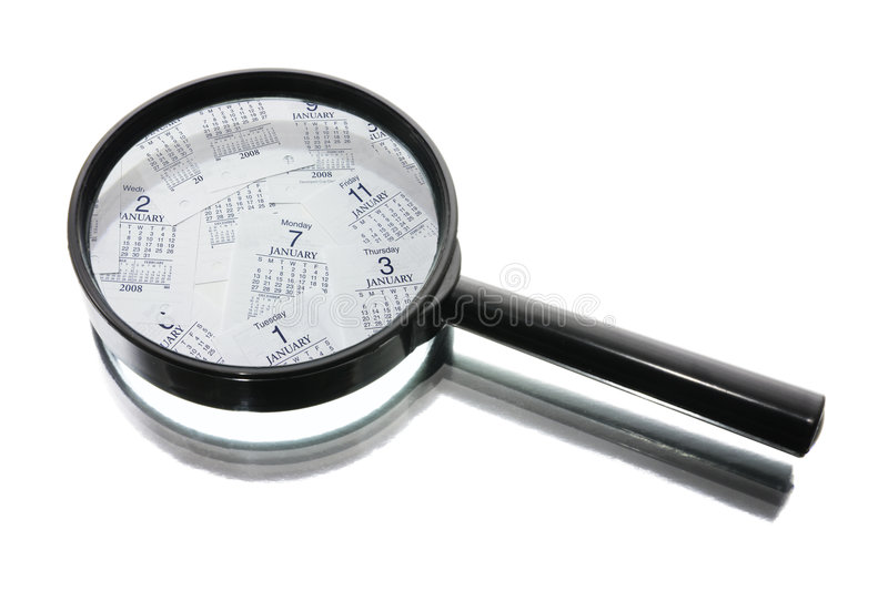 Magnifying Glass and Calendar Pages. On White Background stock photo