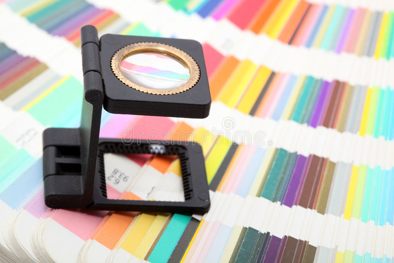 Magnifying glass on colors royalty free stock image