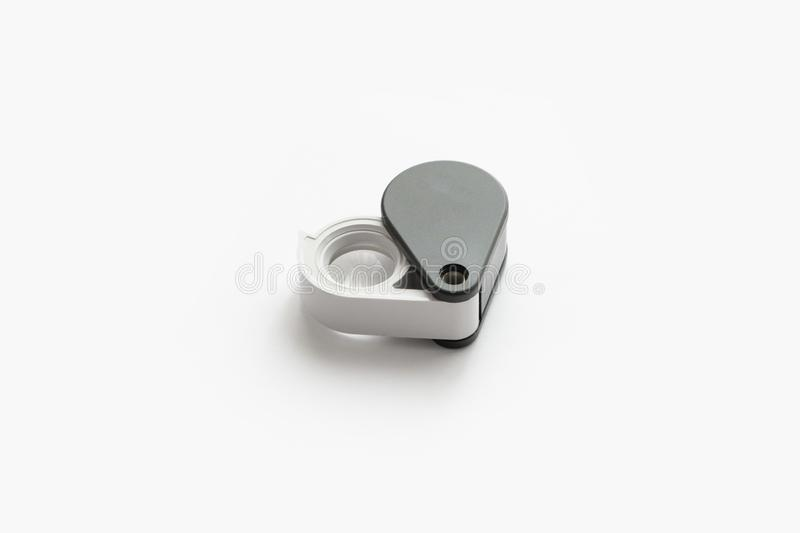 Magnifying glass for diamonds or see the amulet Isolated on a White Background. Eye Lens Magnifier stock photo
