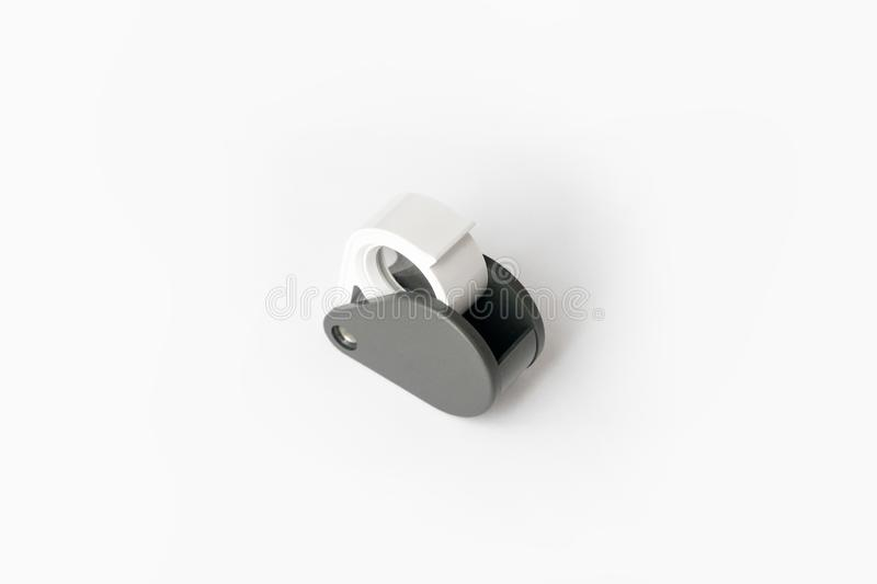 Magnifying glass for diamonds or see the amulet Isolated on a White Background. Eye Lens Magnifier stock photography