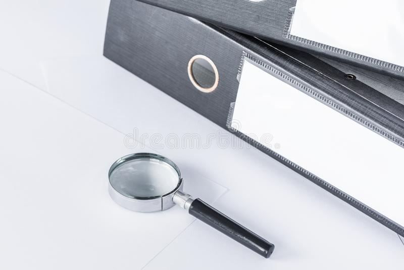 Magnifying glass and document files stock photos