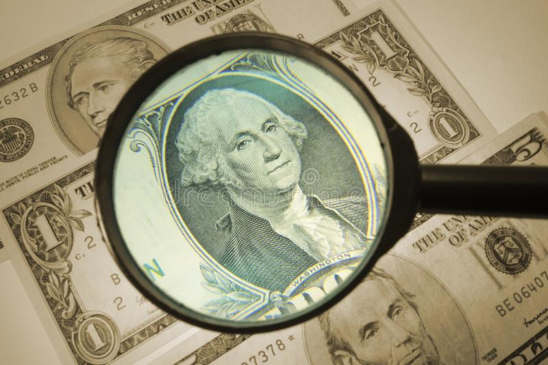 Magnifying Glass on Dollar Notes stock photo