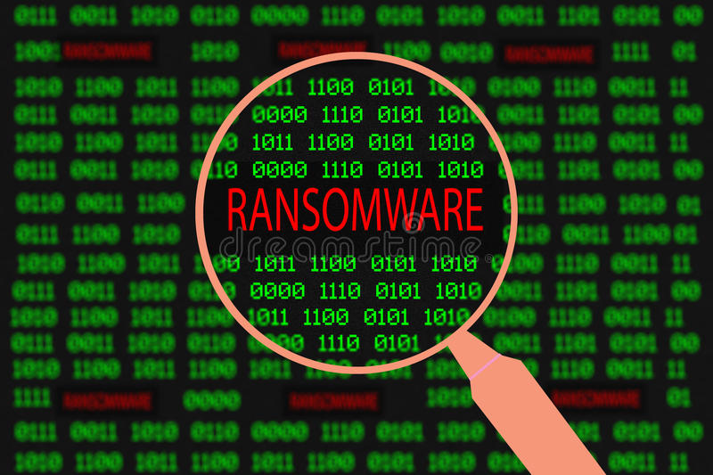 magnifying glass enlarging ransomware in computer machine code stock