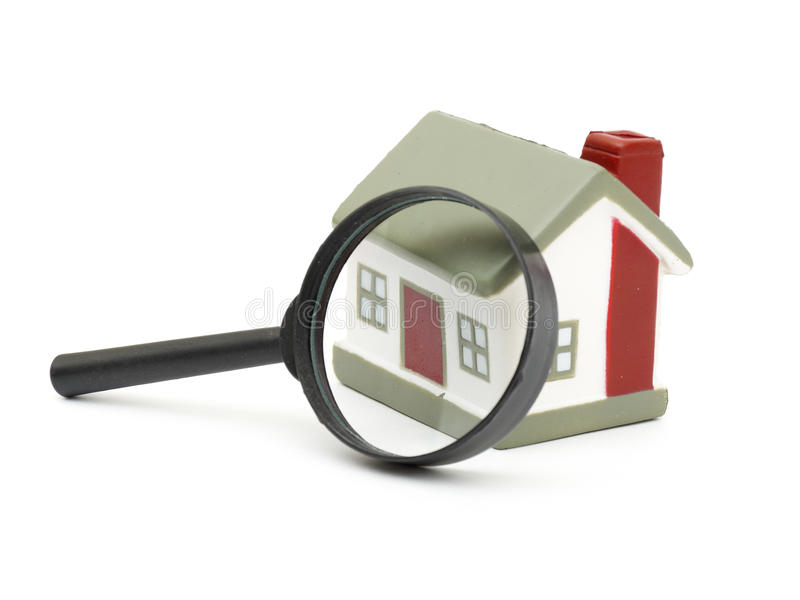 Magnifying glass examining model home royalty free stock images