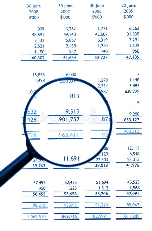 Magnifying Glass On Financial Balance Sheet. Business / Finance, Background, Blue Tone royalty free stock images