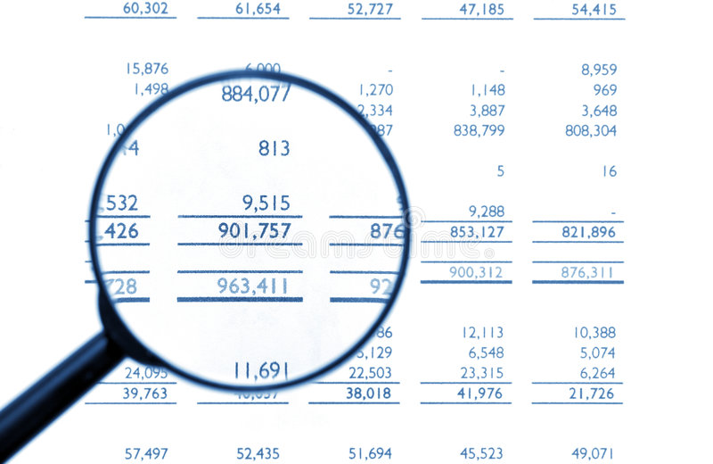 Magnifying Glass On Financial Balance Sheet stock images