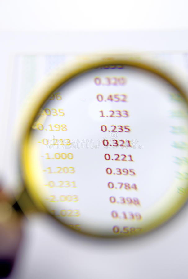 Magnifying glass on financial report stock photos