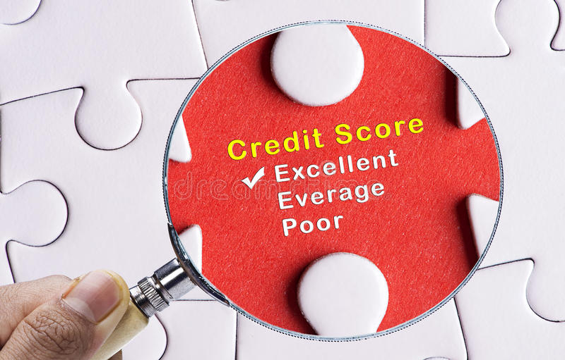Magnifying glass focus on Excellent credit score evaluation form. stock photo