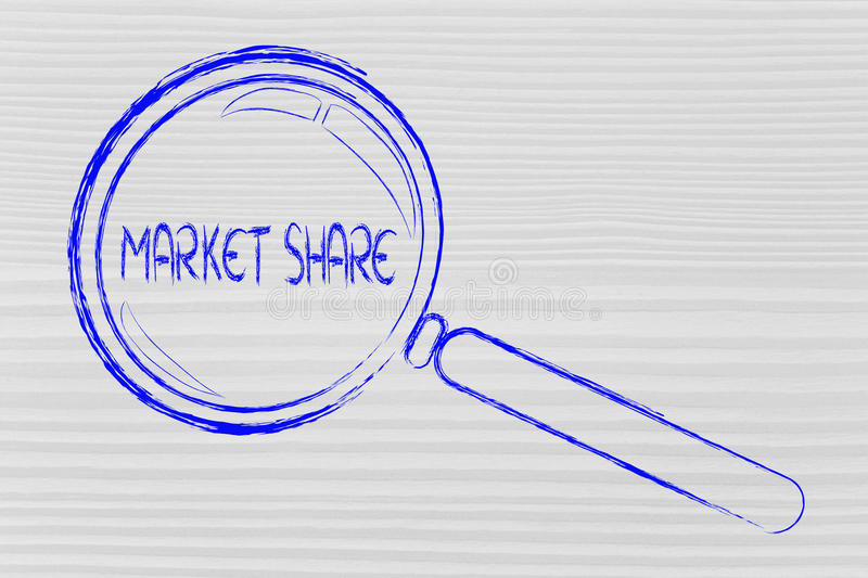 Magnifying glass, focusing on market share royalty free stock photo