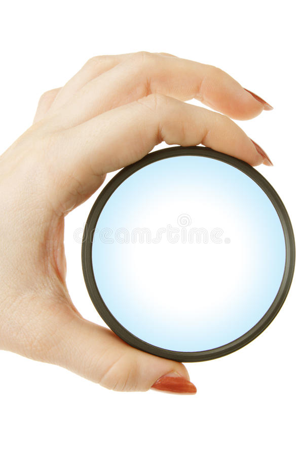 Magnifying glass in hand. A girl holds in her hand magnifying glass on a white background stock image