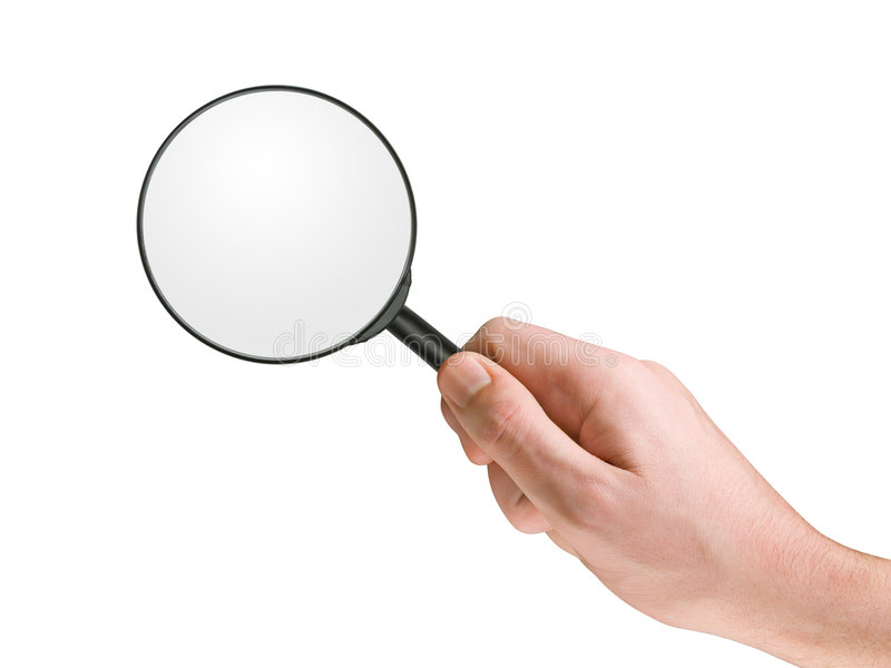 Magnifying glass in hand stock photo