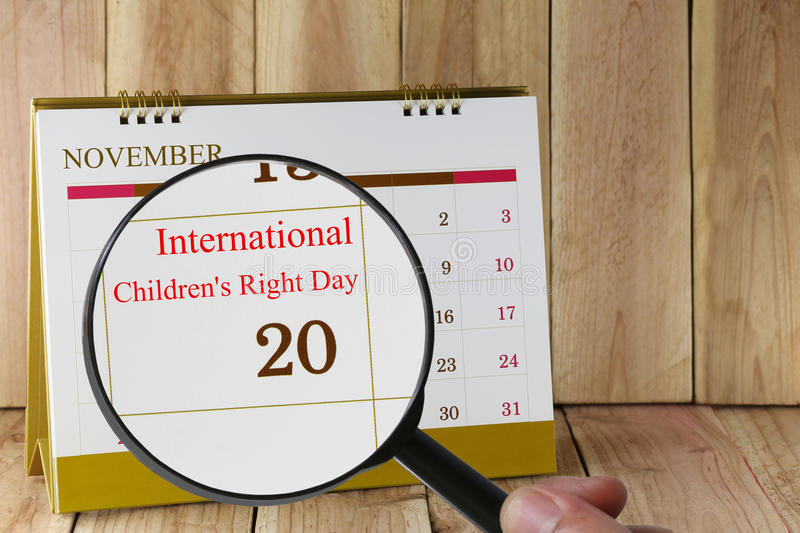 Magnifying glass in hand on calendar you can look International stock images