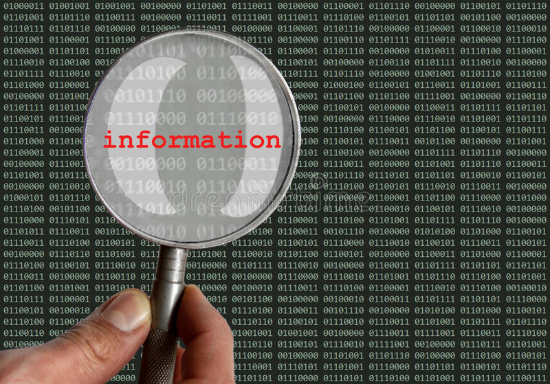 Magnifying glass information hacker stock photo